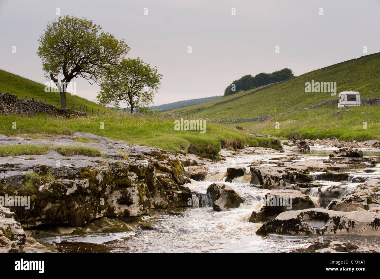 Campervan by River Wharfe, flowing through quiet scenic narrow valley, cascading over limestone rocks - Langstrothdale, Yorkshire Dales, England, UK. Stock Photo