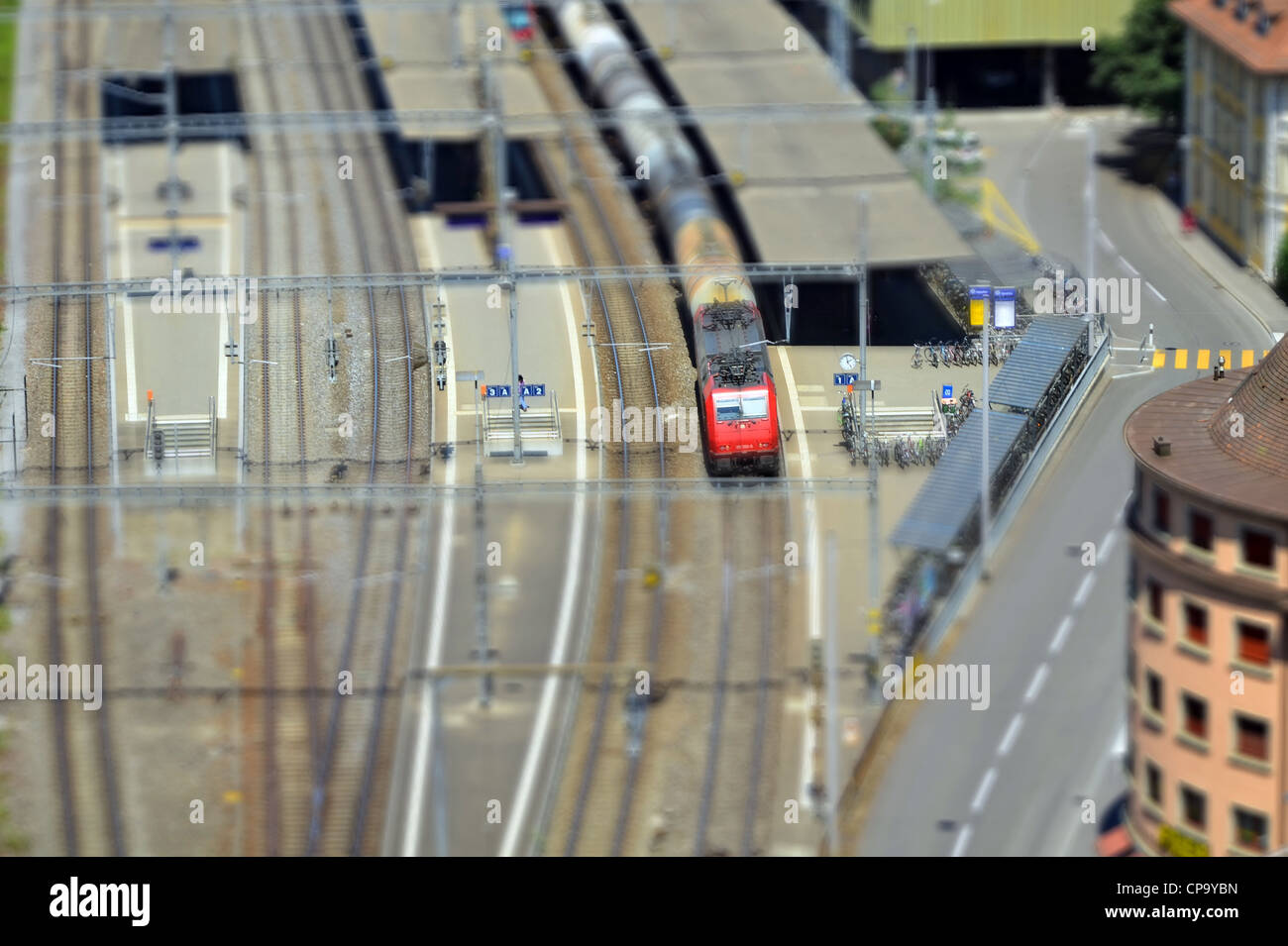 Railway station at Switzerland with Tilt and shift (or Toy) effect . - Stock Image