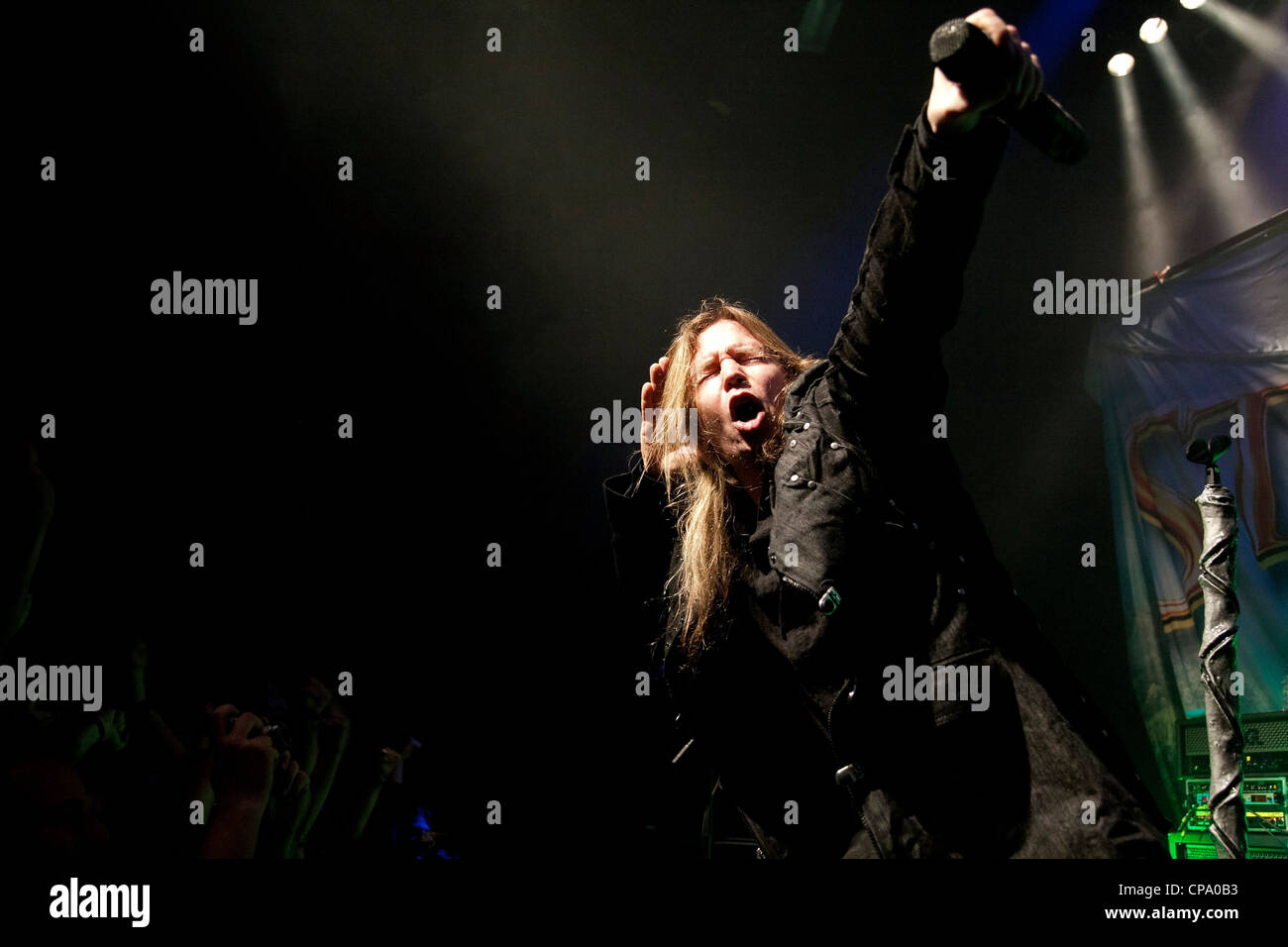 Vocalist of the Stratovarius power metal band Timo Kotipelto listens to the audience in rock concert in Thessaloniki, - Stock Image