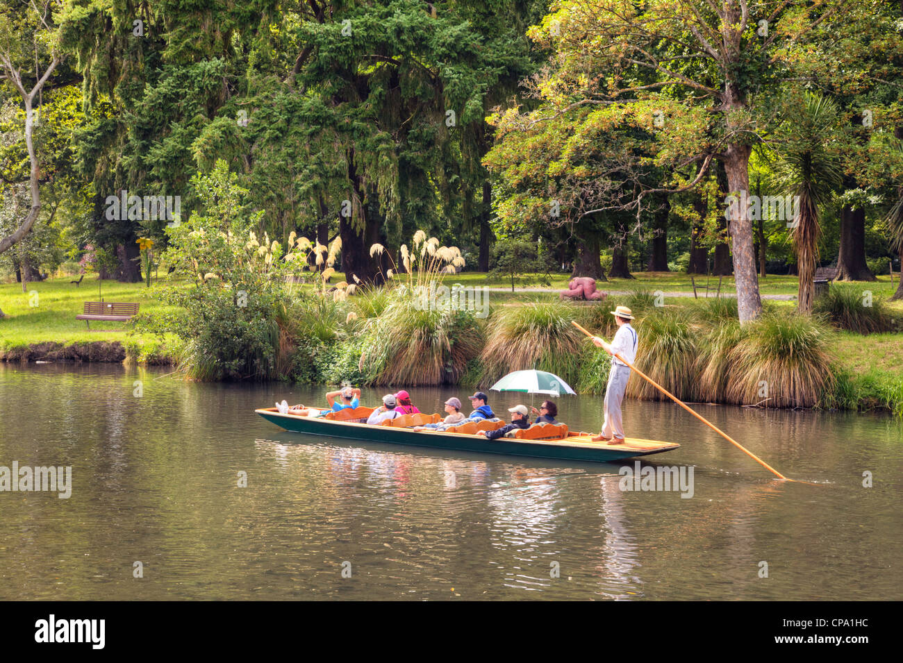 Tourists in a punt on the Avon River, passing through Hagley Park, in Christchurch, New Zealand, 6 February 2011. - Stock Image