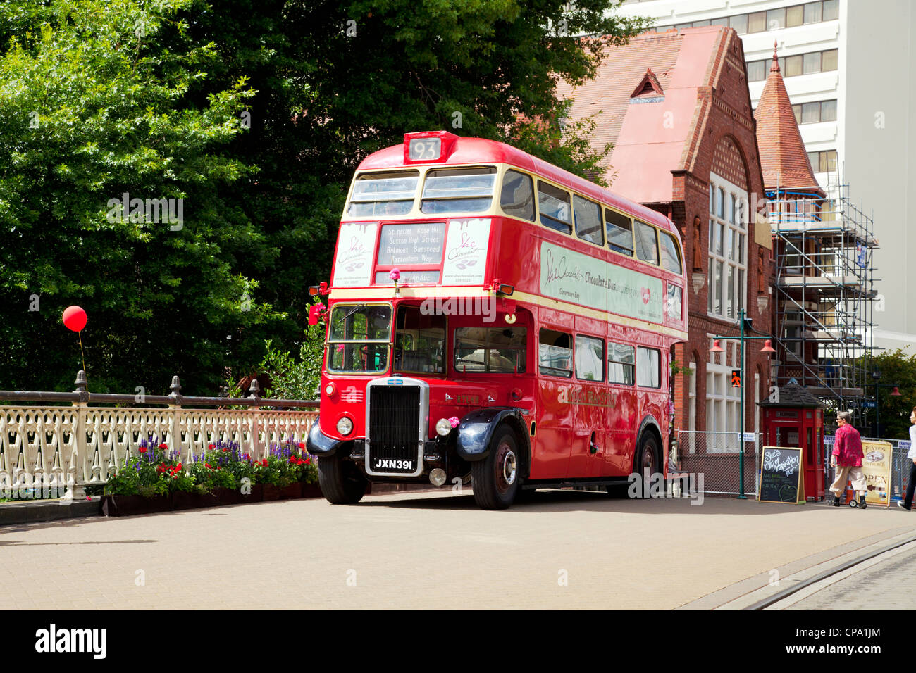 London Transport red double decker bus in Christchurch, New Zealand, ready to take tourists on a tour of the city. - Stock Image