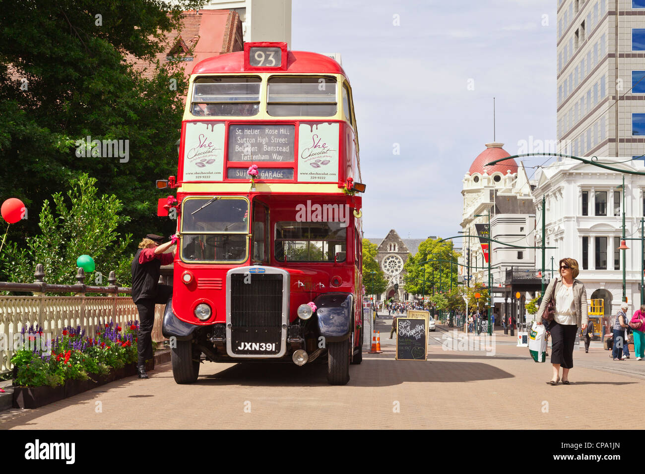 London Transport red double decker bus just about to set off on a tour of Christchurch. - Stock Image