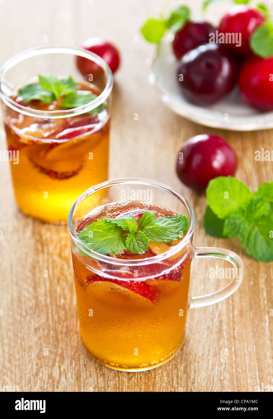 Plum juice with fresh plum and mint - Stock Image