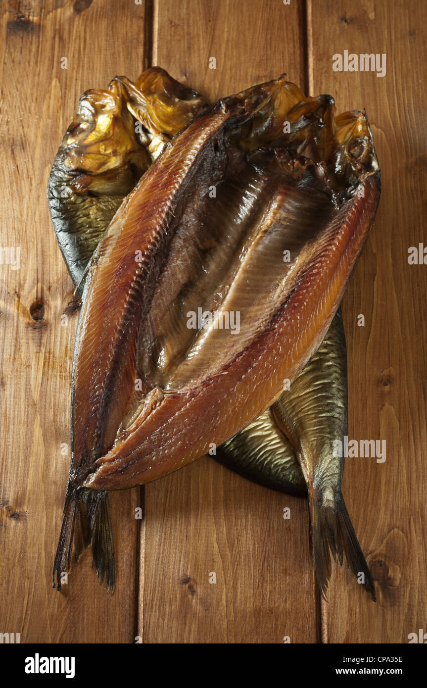 Traditional whole kippers Smoked herrings - Stock Image