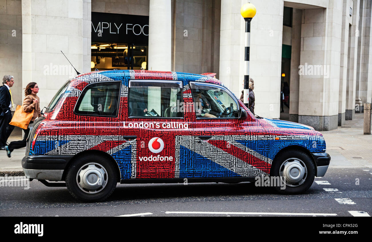 London taxi in Vodafone's Union Jack livery, London, England. - Stock Image