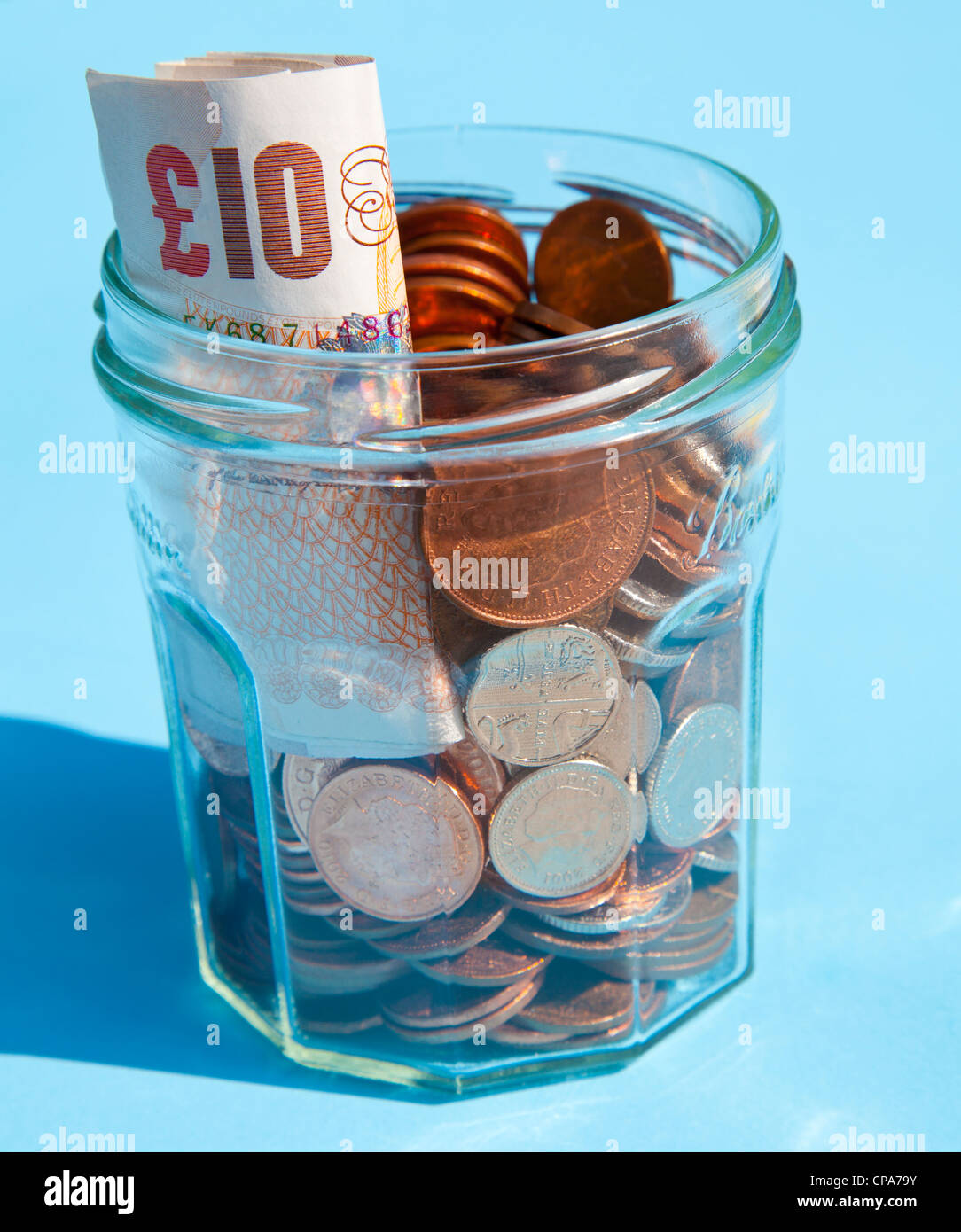 Savings in a jam jar - Stock Image