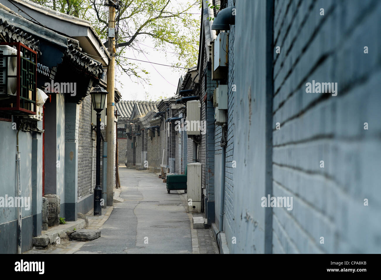 View along traditional historic old lane or hutong in Beijing China - Stock Image