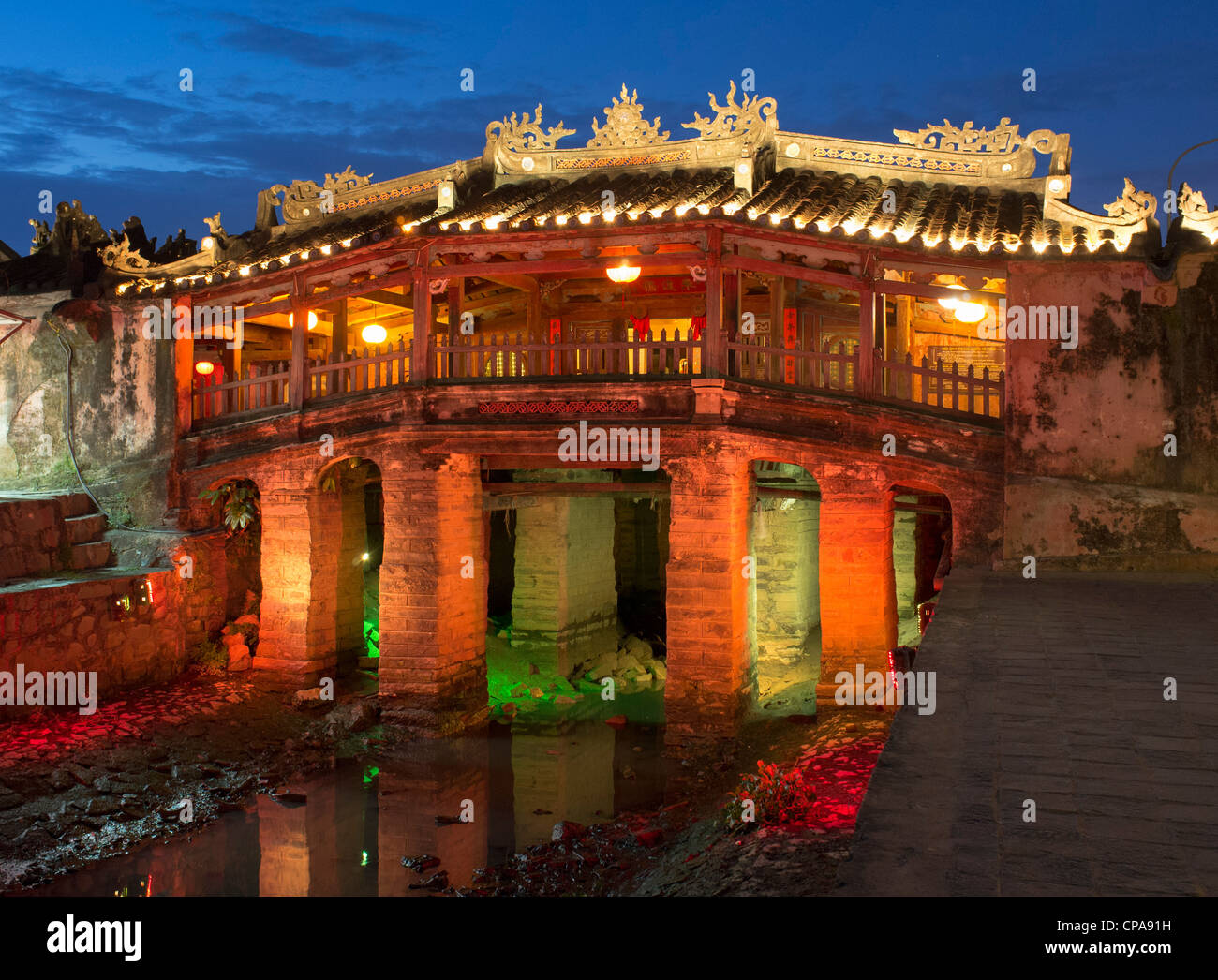 Illuminated night view of historic Japanese covered bridge in UNESCO heritage town of Hoian in Vietnam - Stock Image