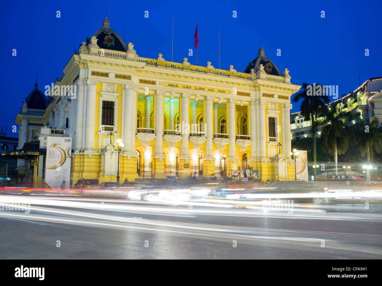 Night view of Hanoi Opera House with traffic Vietnam - Stock Image