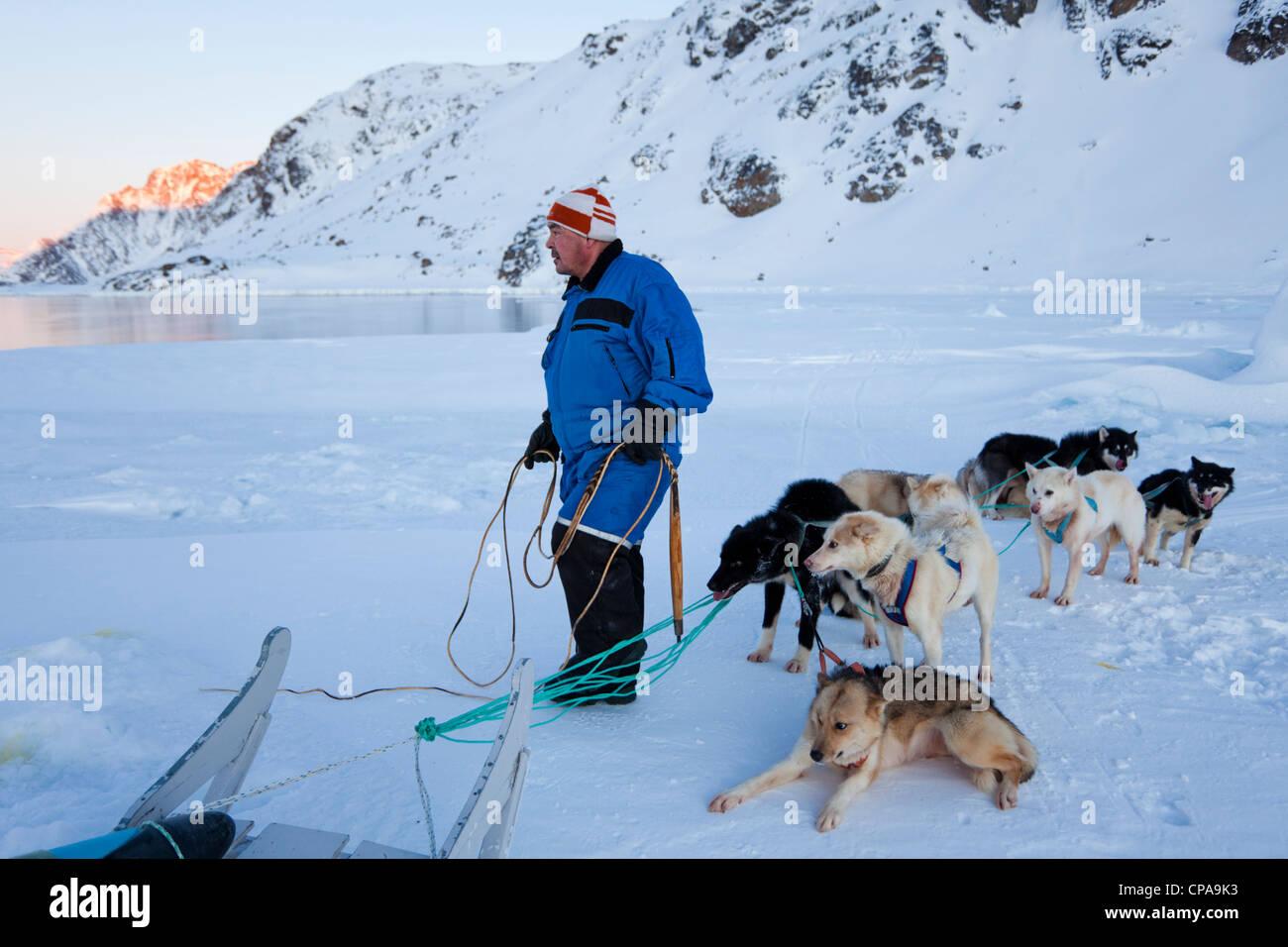 Inuit husky dog handler / owner - Greenland - Stock Image