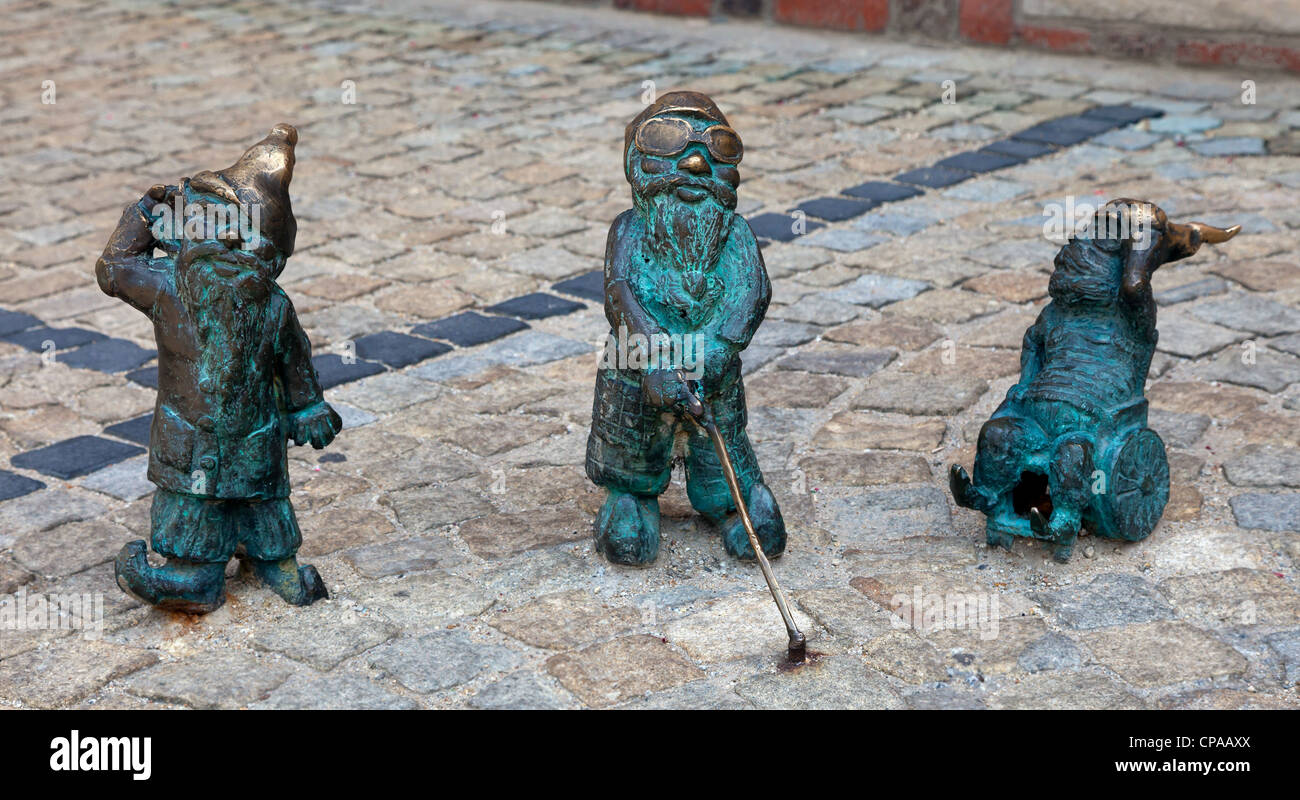 These little bronze sculptures of fairy-tale gnomes are far from the tourist-industry icons that they first appear - Stock Image