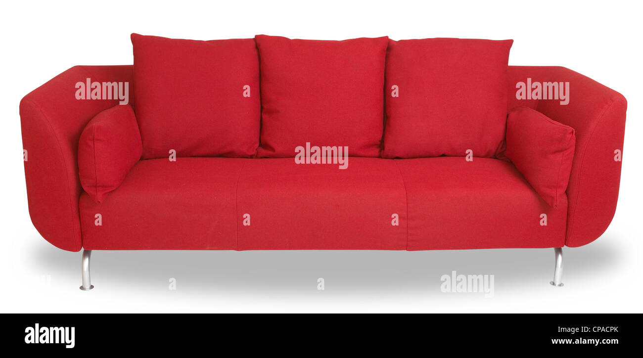 a comfy red couch sofa isolated on white with clipping path - Stock Image