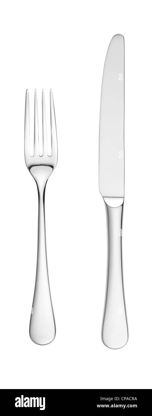an overhead shot of a chrome silver knife and fork isolated on white with paths - Stock Image