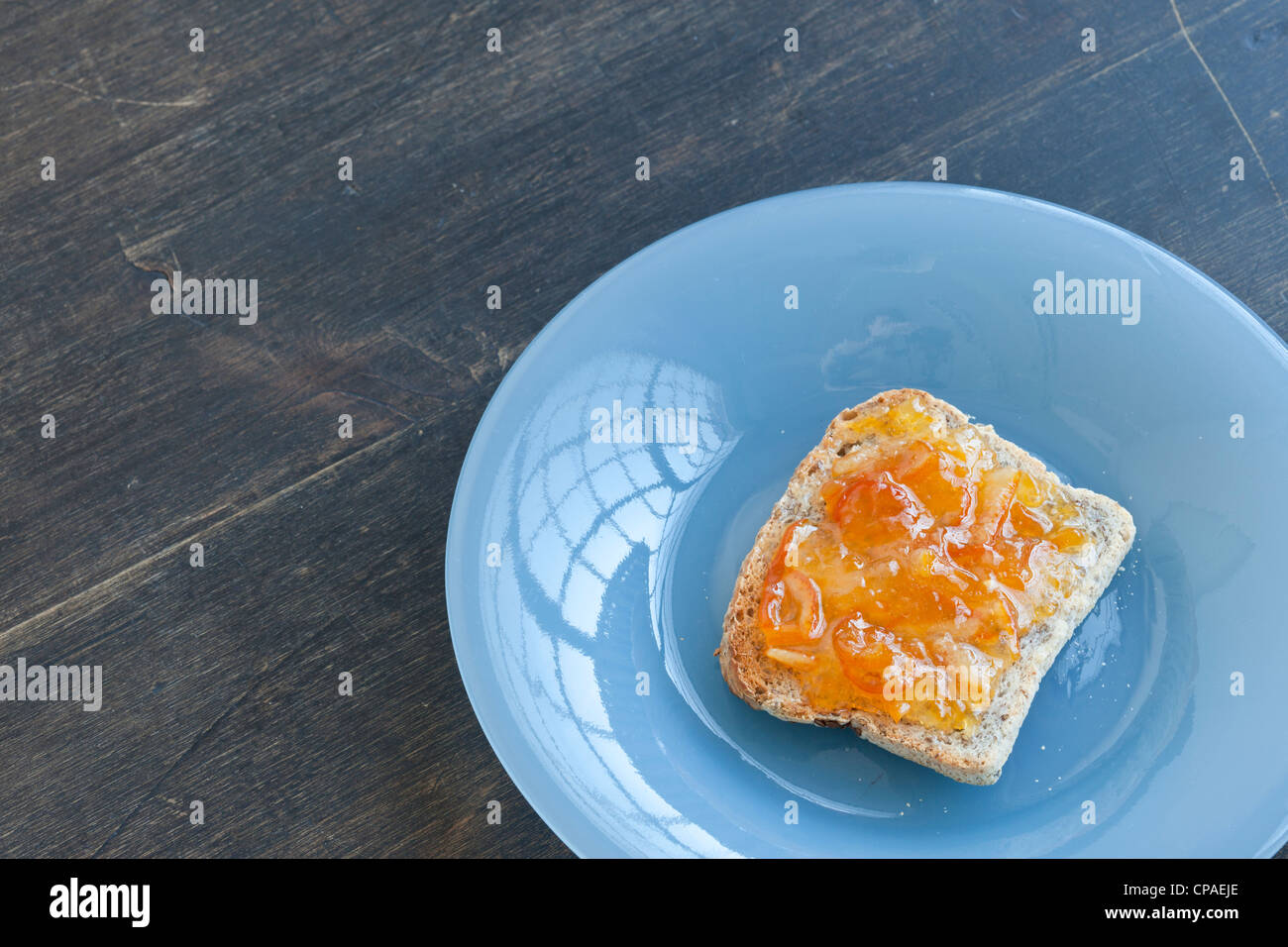 orange Marmalade on Gluten-free flax toast ( glutino Brand ) home made maramalade - Stock Image