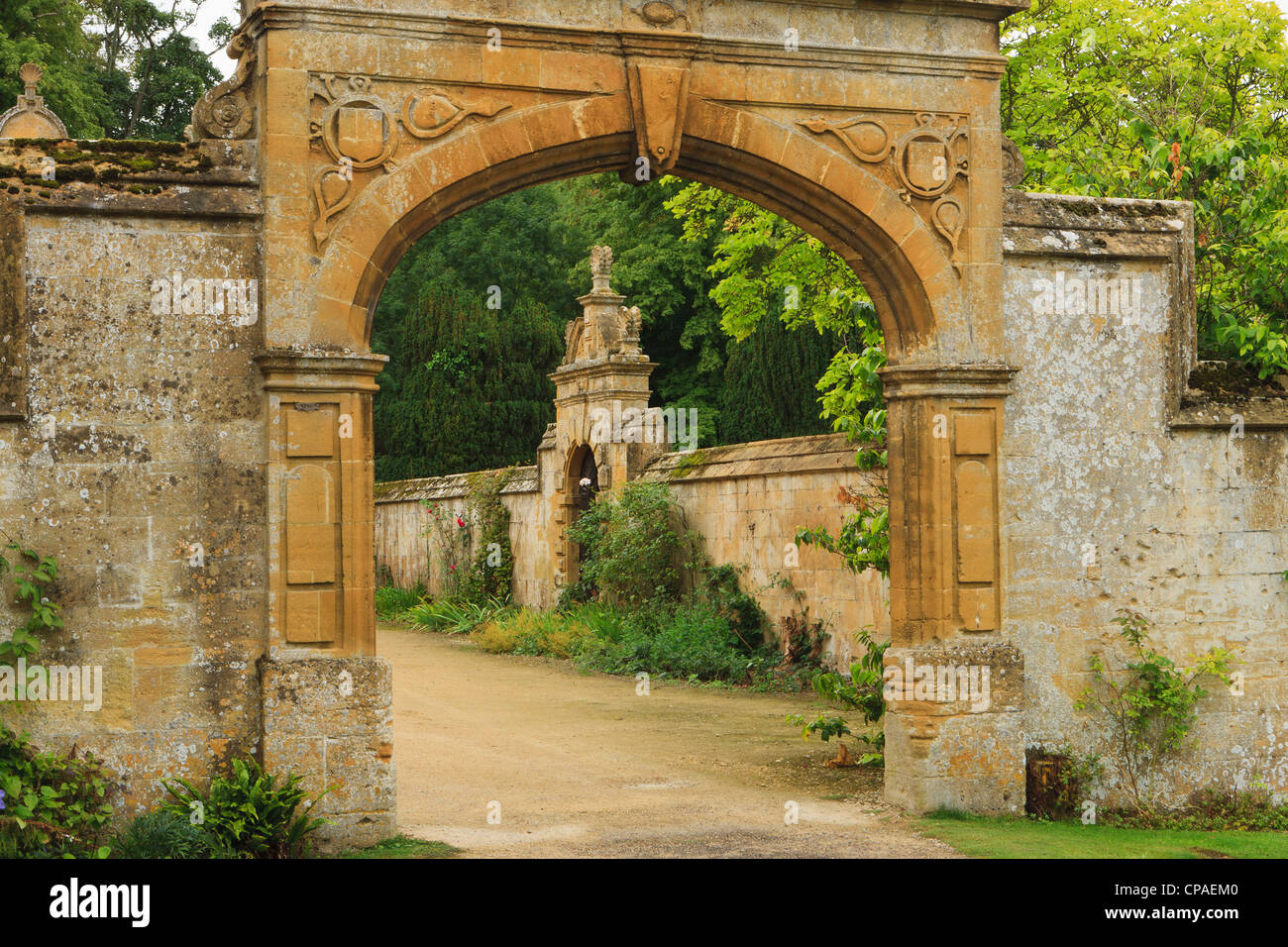 Stonewall entrance to Stanway House, a castle in Cotswolds in Southwestern England. Stock Photo