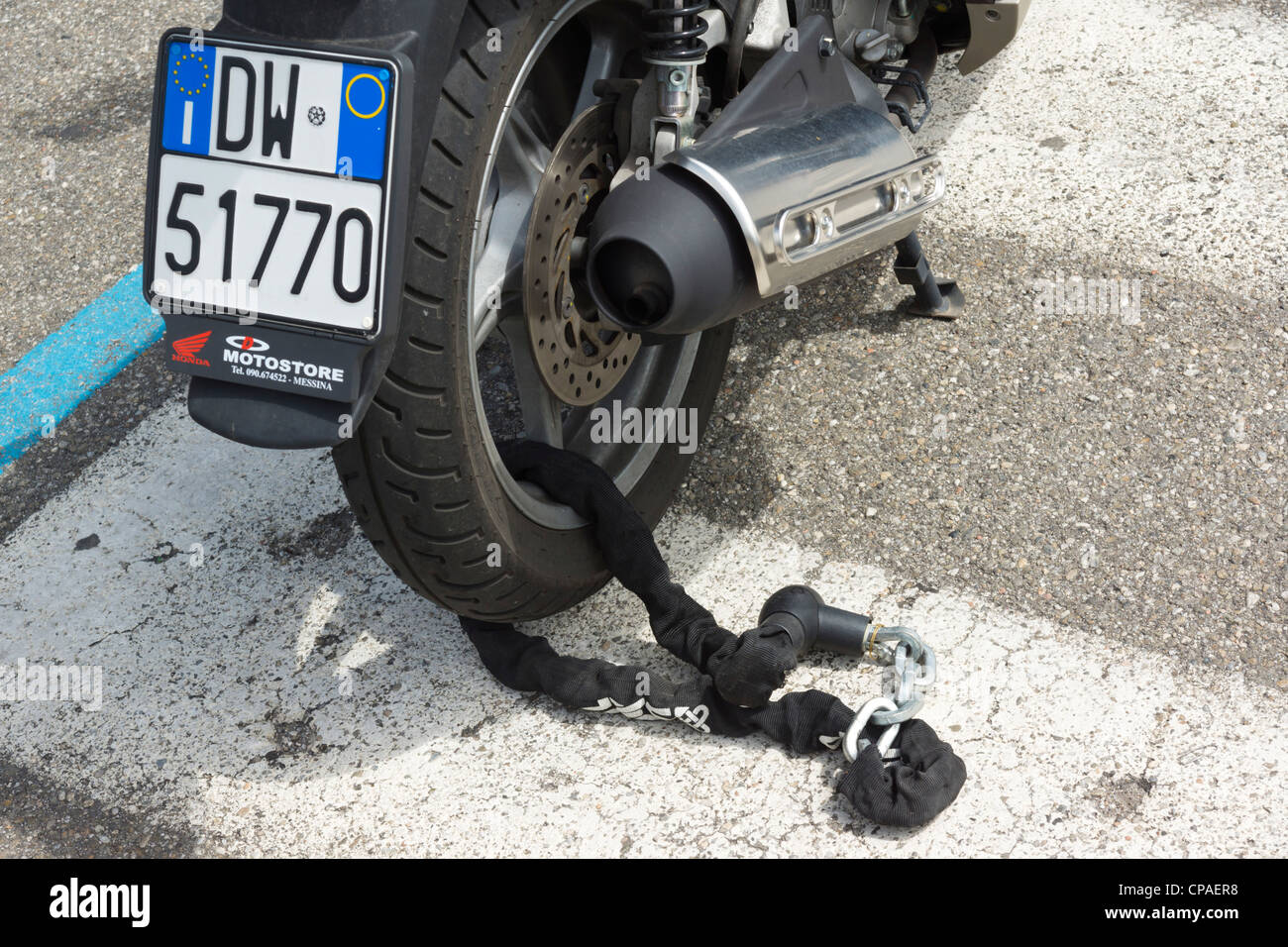 Messina, Sicily, Italy - local commuting, motorbikes or scooters. Anti-theft chain on rear wheel. - Stock Image