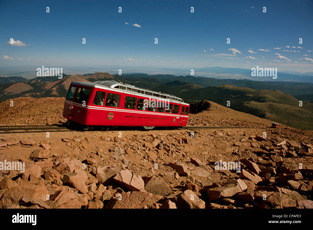 USA, Colorado, Pikes Peak. Red cars of the Manitou and Pikes Peak Cog Railway carrying tourists to the top of Pikes - Stock Image
