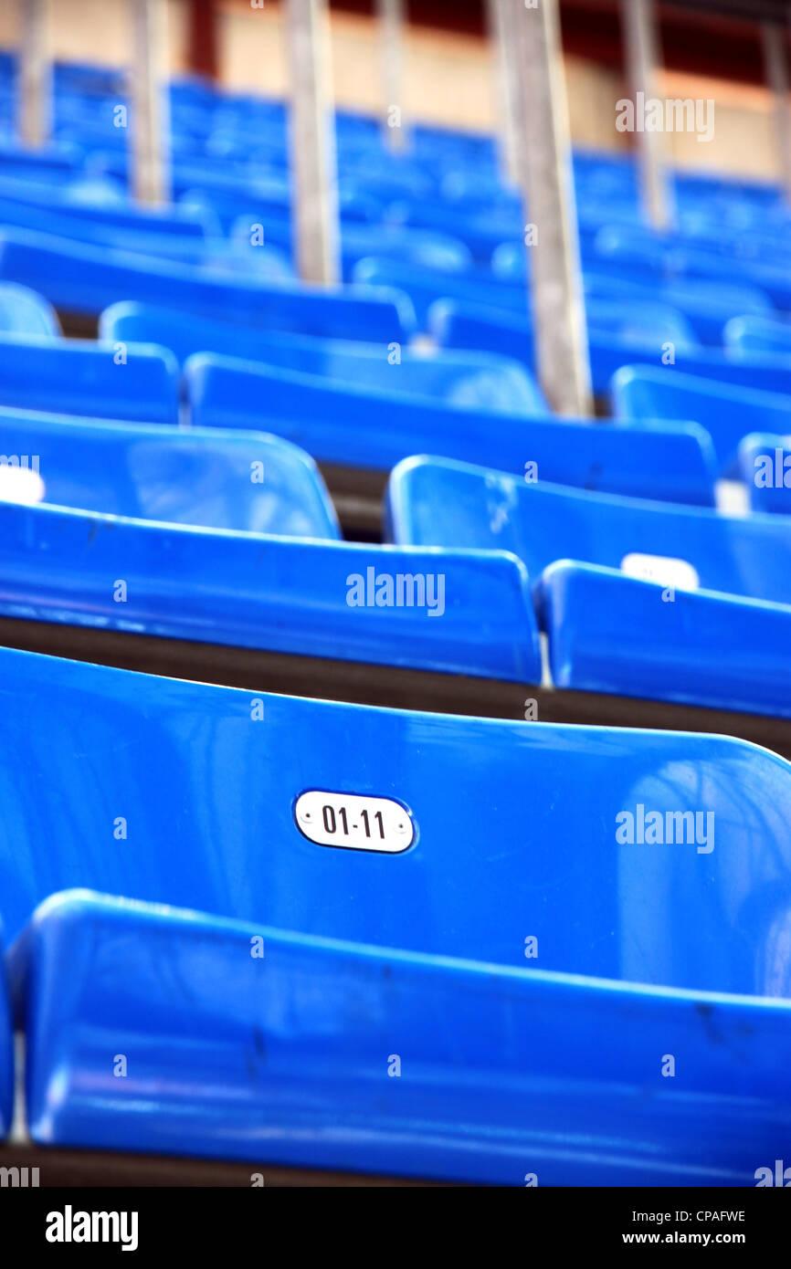 Blue stadium seats at San Siro Stadium in Milan, Italy Stock Photo