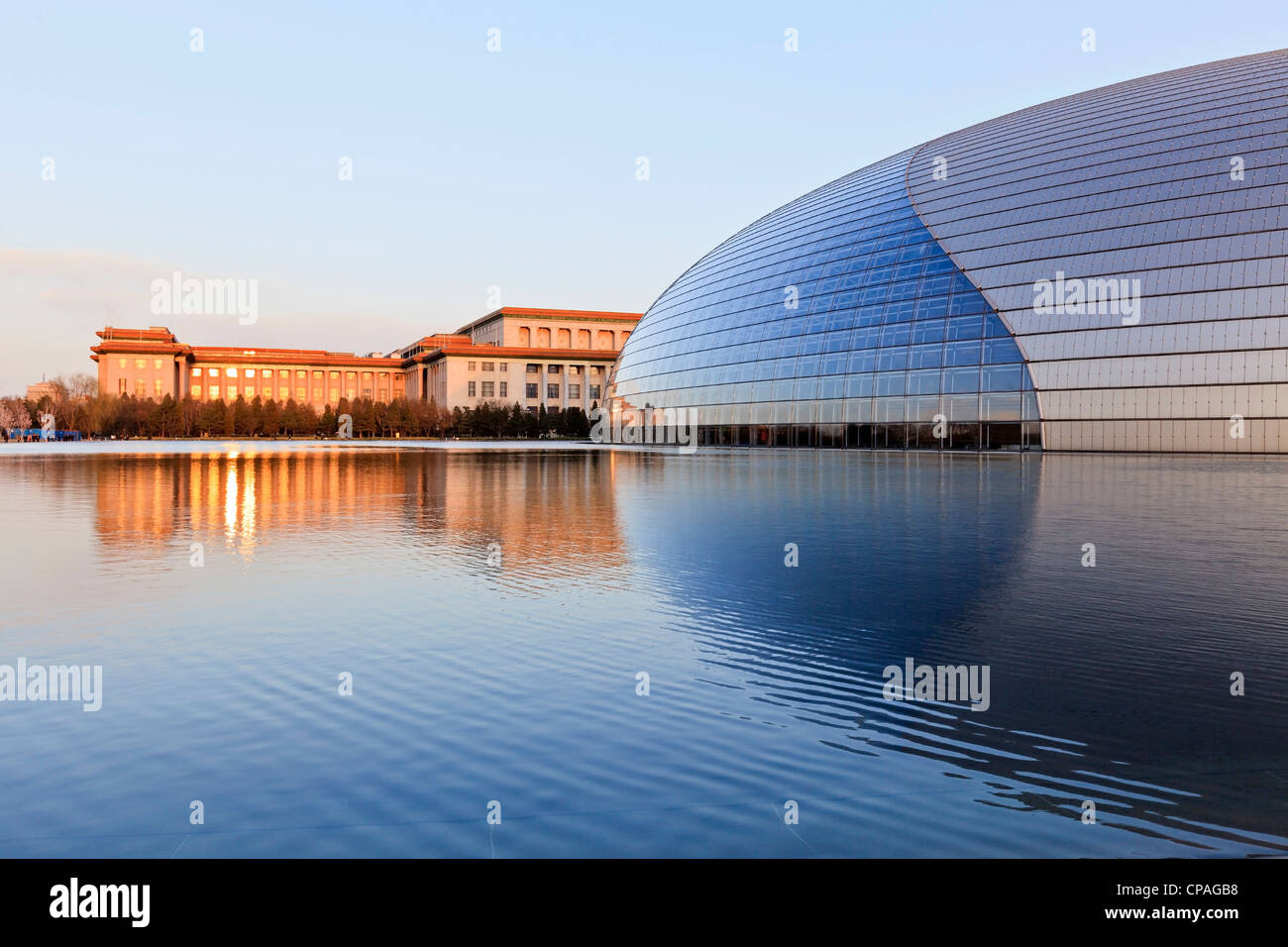 National Centre for the Performing Arts, Beijing, China and the Great Hall of the People at sunset. - Stock Image