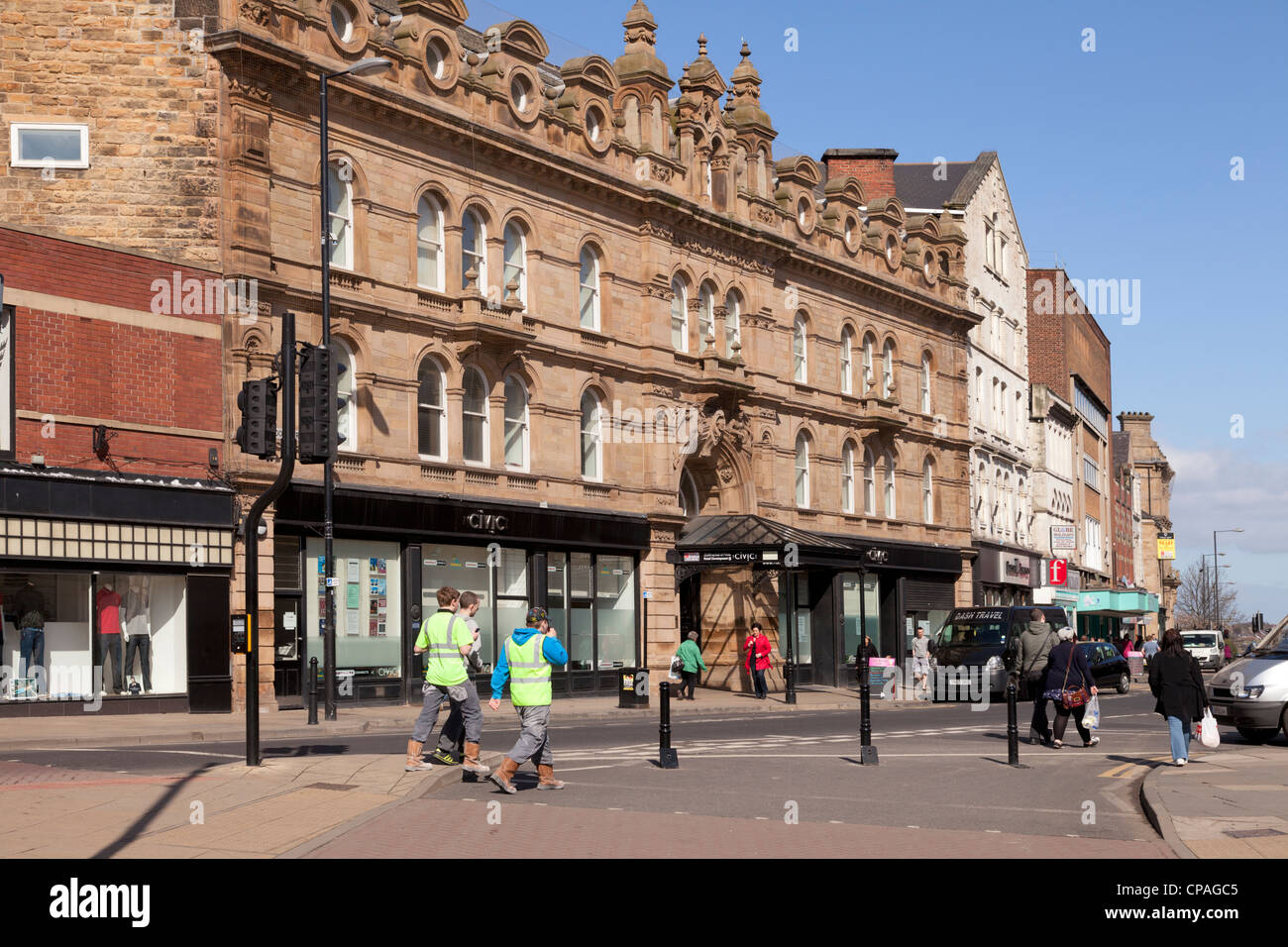 The Civic Centre, an old sandstone building in Barnsley, South Yorkshire, people walking by. - Stock Image