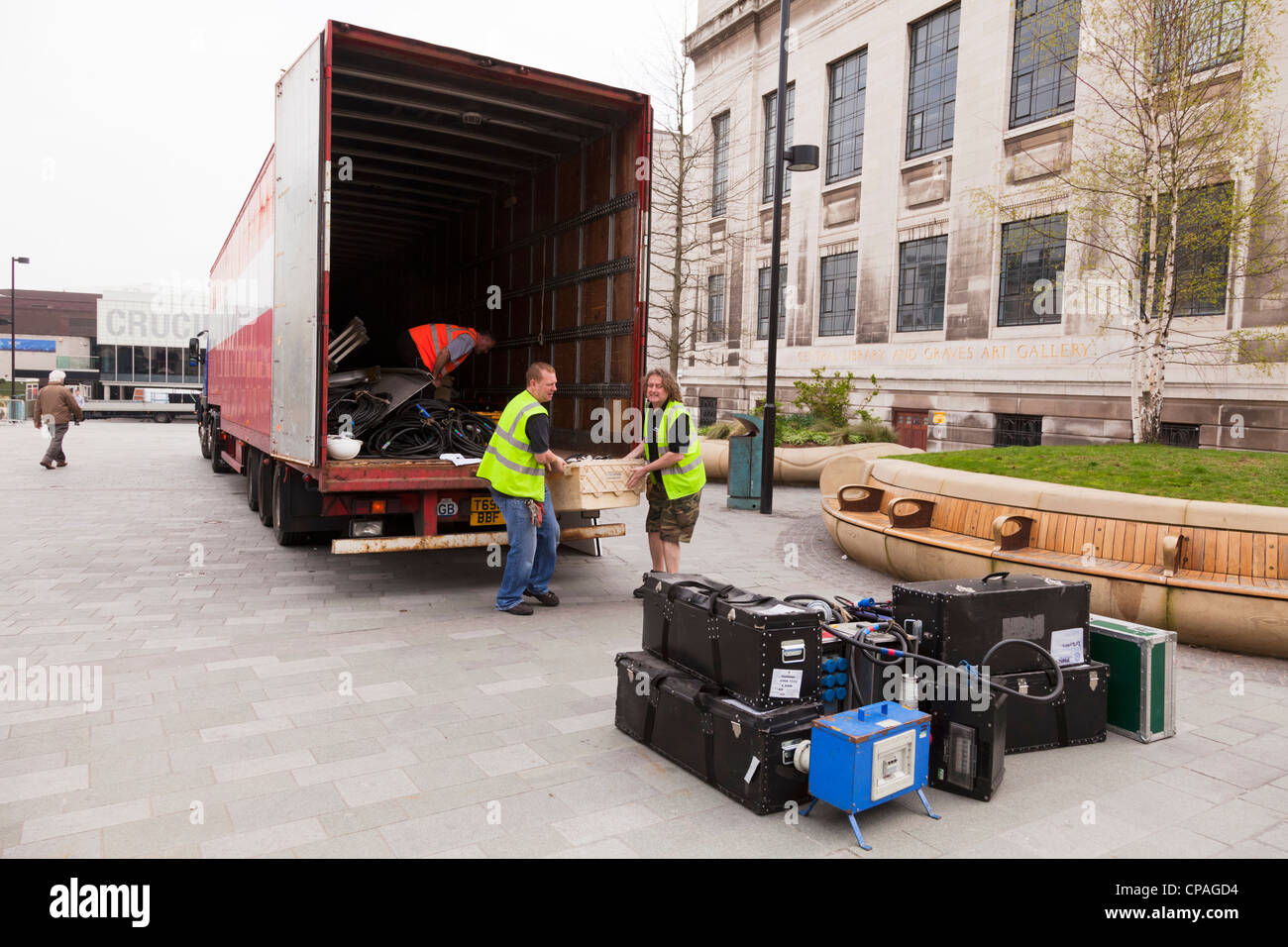 Workmen unloading sound and video equipment from a large lorry near the Central Library, Sheffield, South Yorkshire, - Stock Image