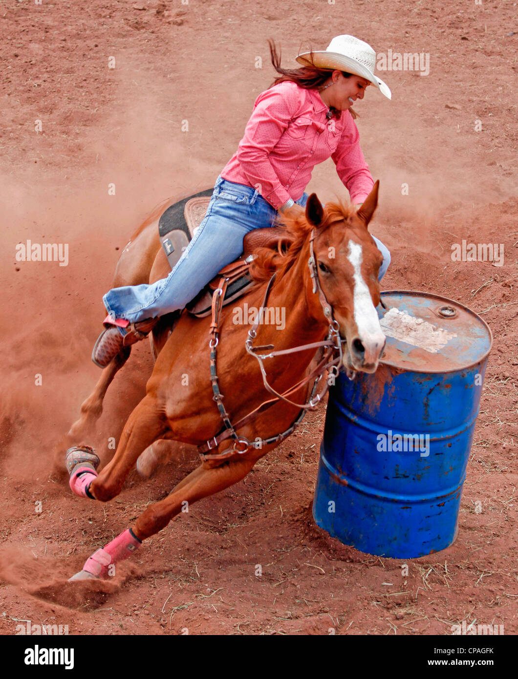 USA, New Mexico, Mescalero. Woman competing in the barrel racing event at the Annual Indian Rodeo held in Mescalero, - Stock Image