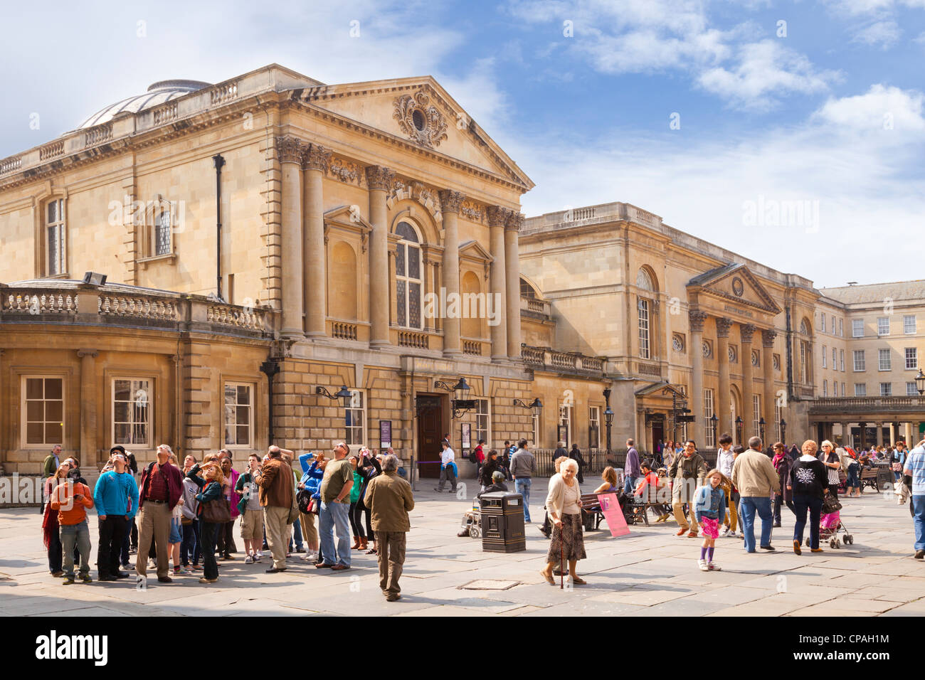 Crowds in front of the Roman Baths in Bath, Somerset, England, on a bright sunny day. - Stock Image