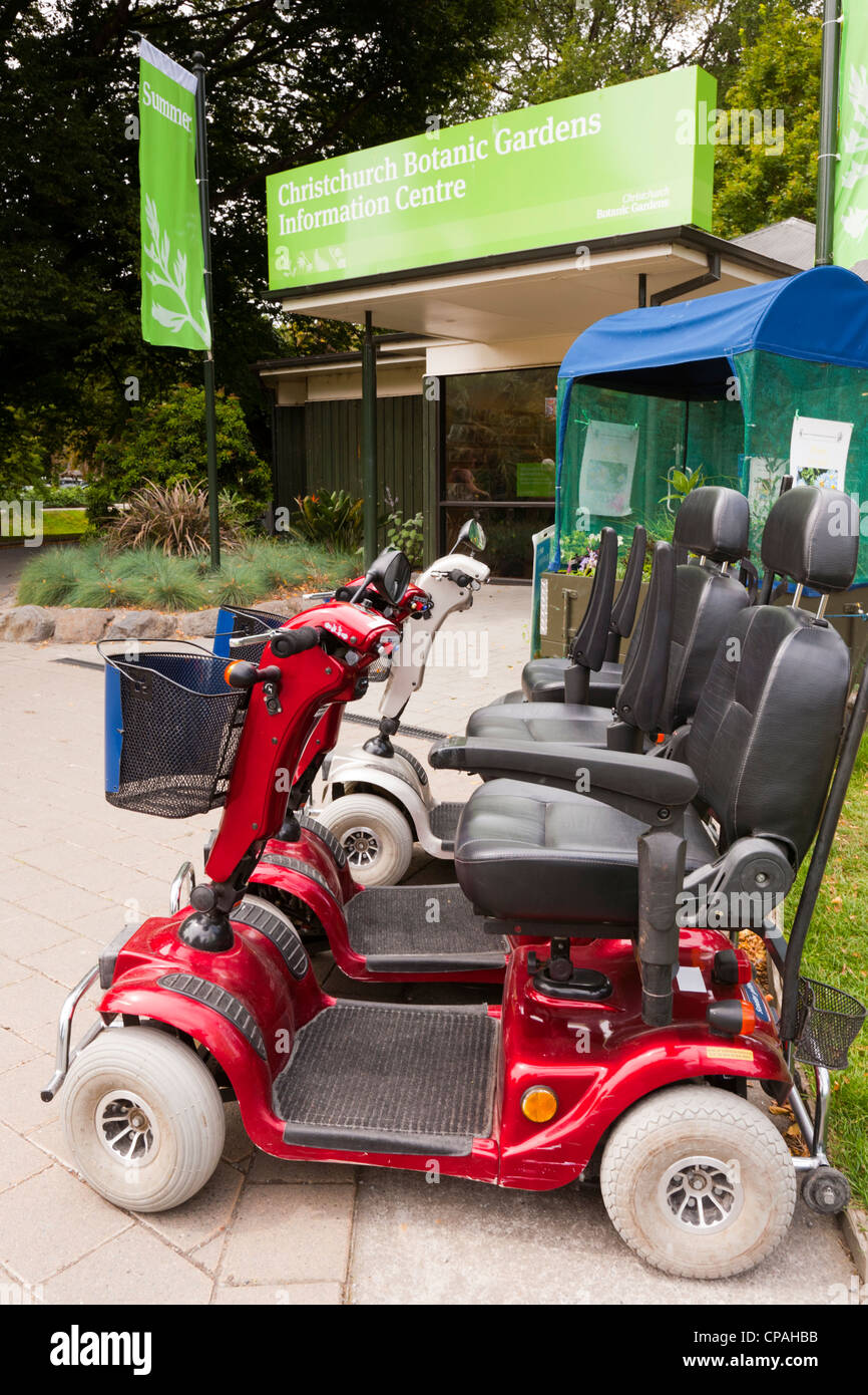 Mobility scooters for hire, outside the Information Centre in the Botanic Gardens, Christchurch, New Zealand. - Stock Image
