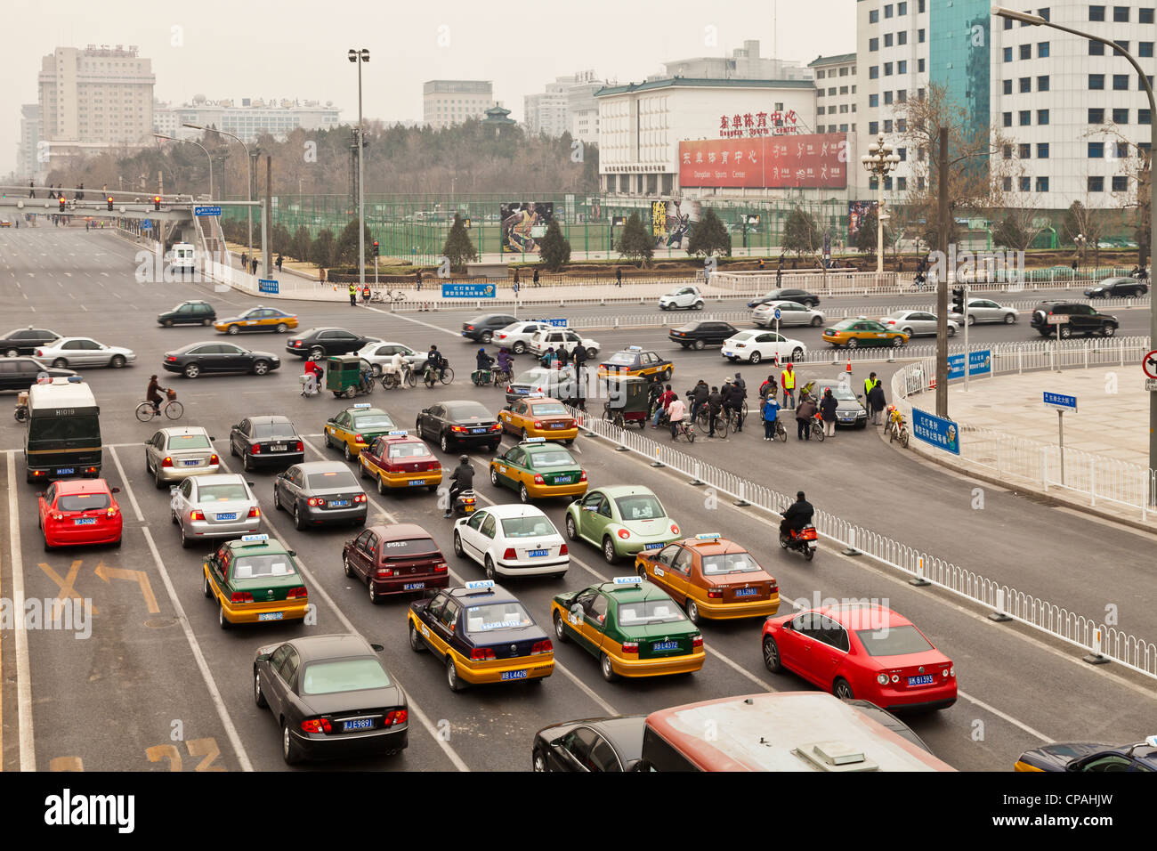 Morning rush hour in Beijing, China, with cars, bikes and the pollution for which the city is infamous - Stock Image