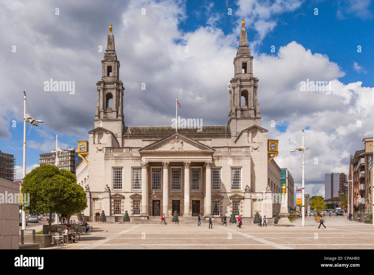 A view across Millenium Square to the Victorian facade of City Council on a sunny day in Leeds, West Yorkshire, - Stock Image
