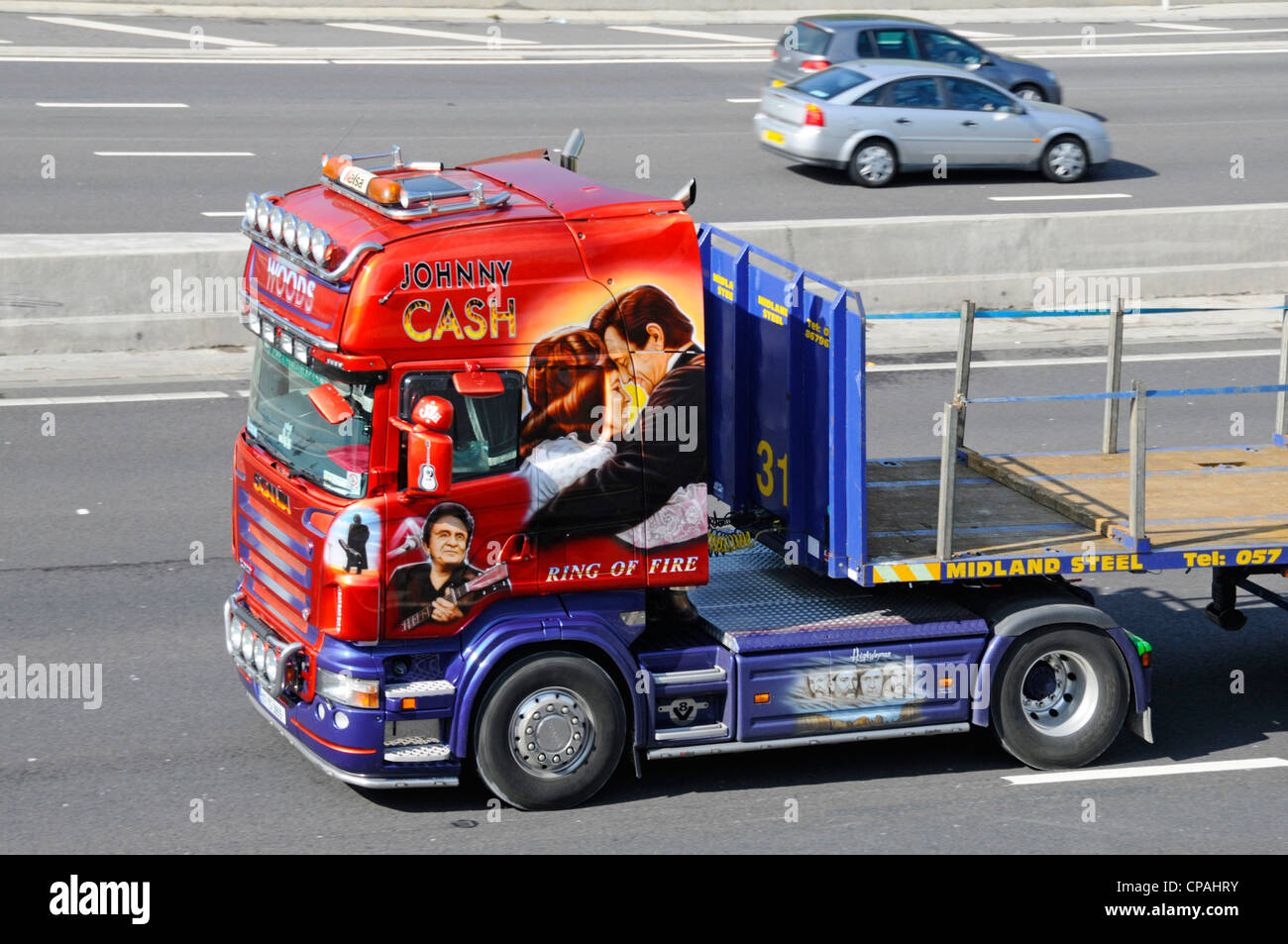 Scania truck cab with Johnny Cash graphics - Stock Image