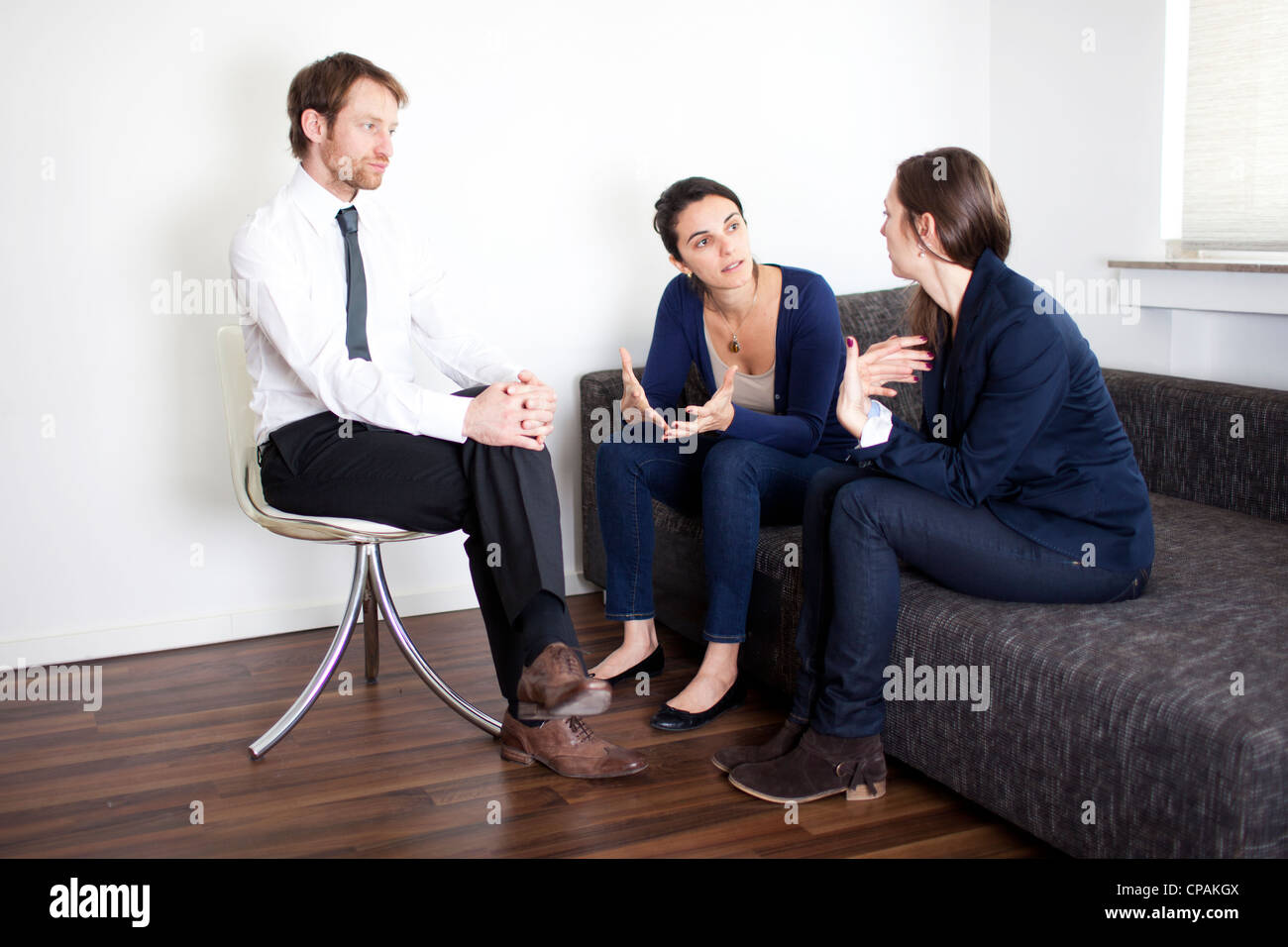 problem solving between business partners at therapy - Stock Image