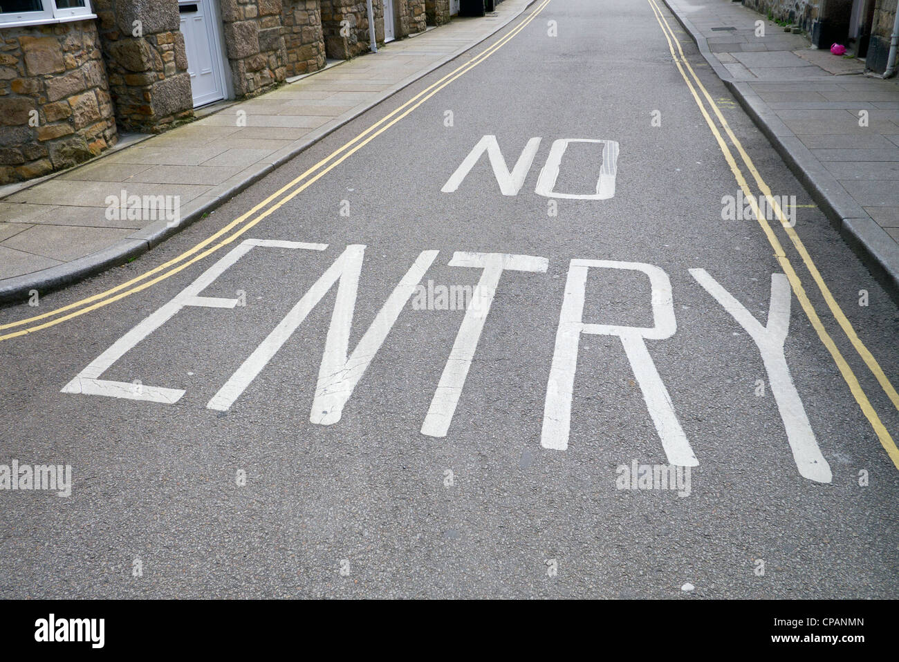 No Entry words in white paint on a road. - Stock Image