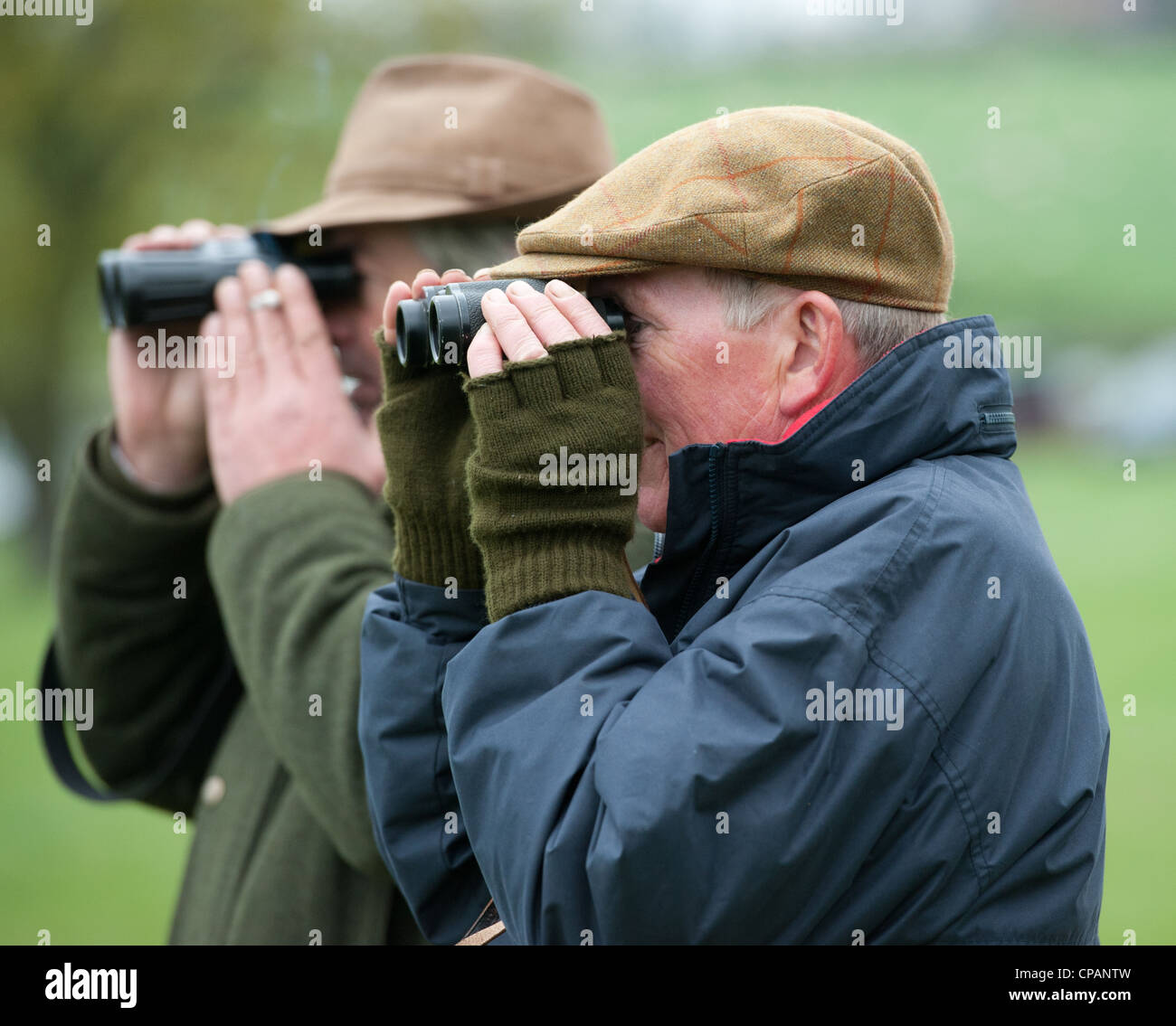Watching horse racing with Binoculars - Stock Image