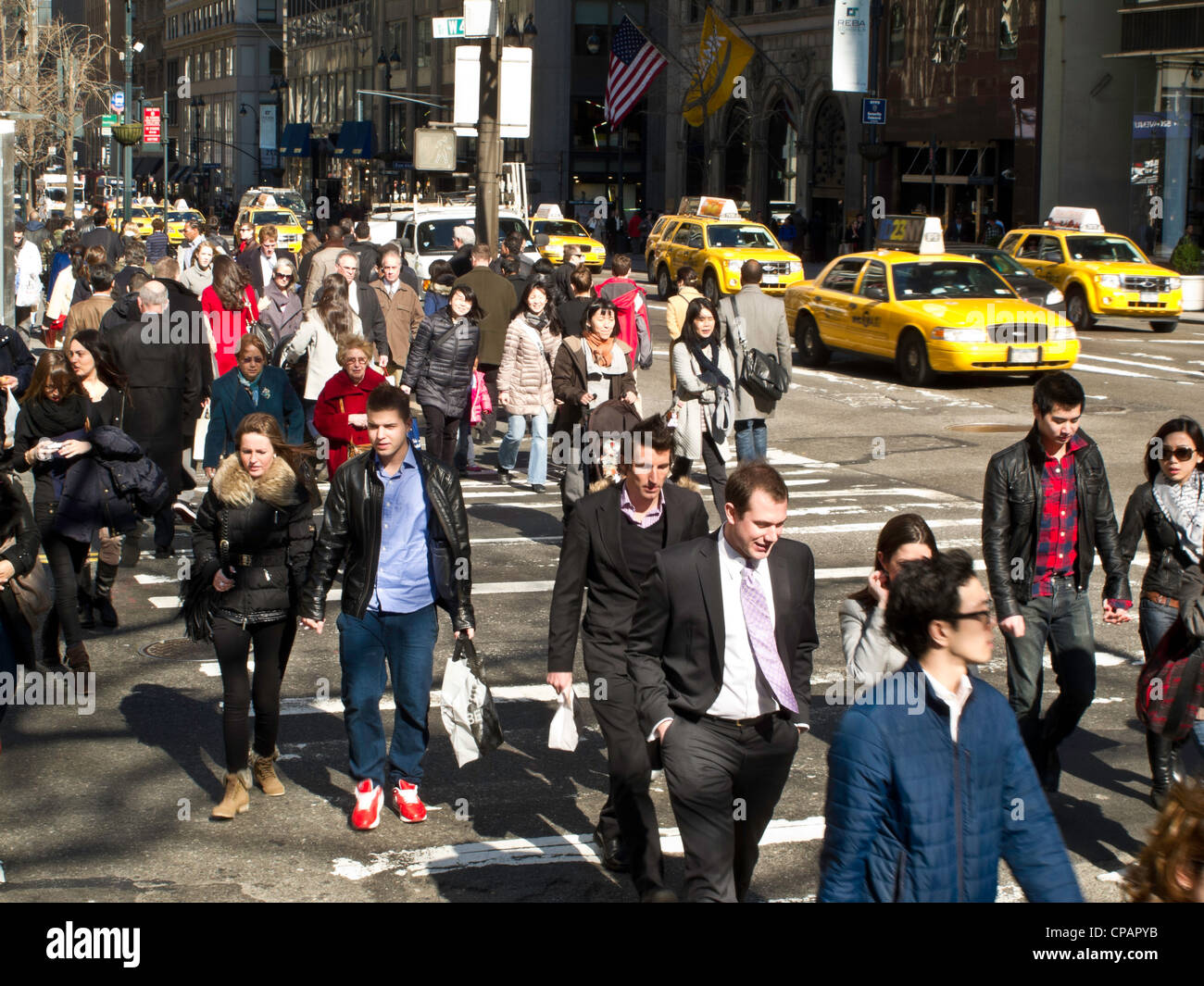 Crowds, 42nd Street and Fifth Avenue, NYC - Stock Image