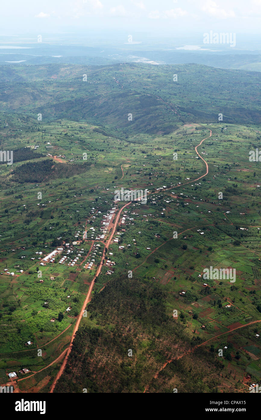 Aerial view of buildings and settlements along a road on the outskirts of Kigali, Rwanda. - Stock Image