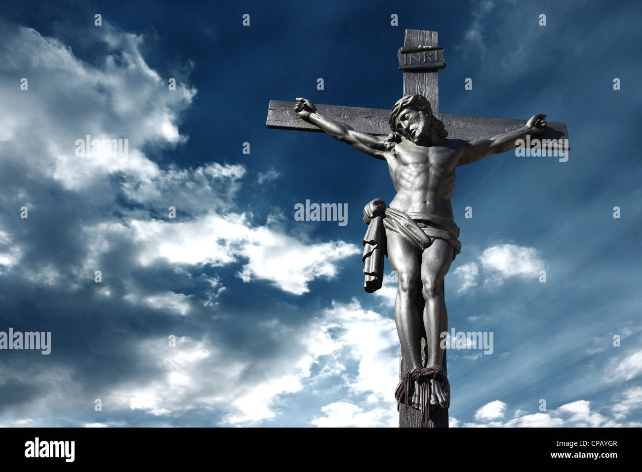 Illustration of the crucifixion of Jesus Christ with a stormy sky recalling the anger of God - Stock Image