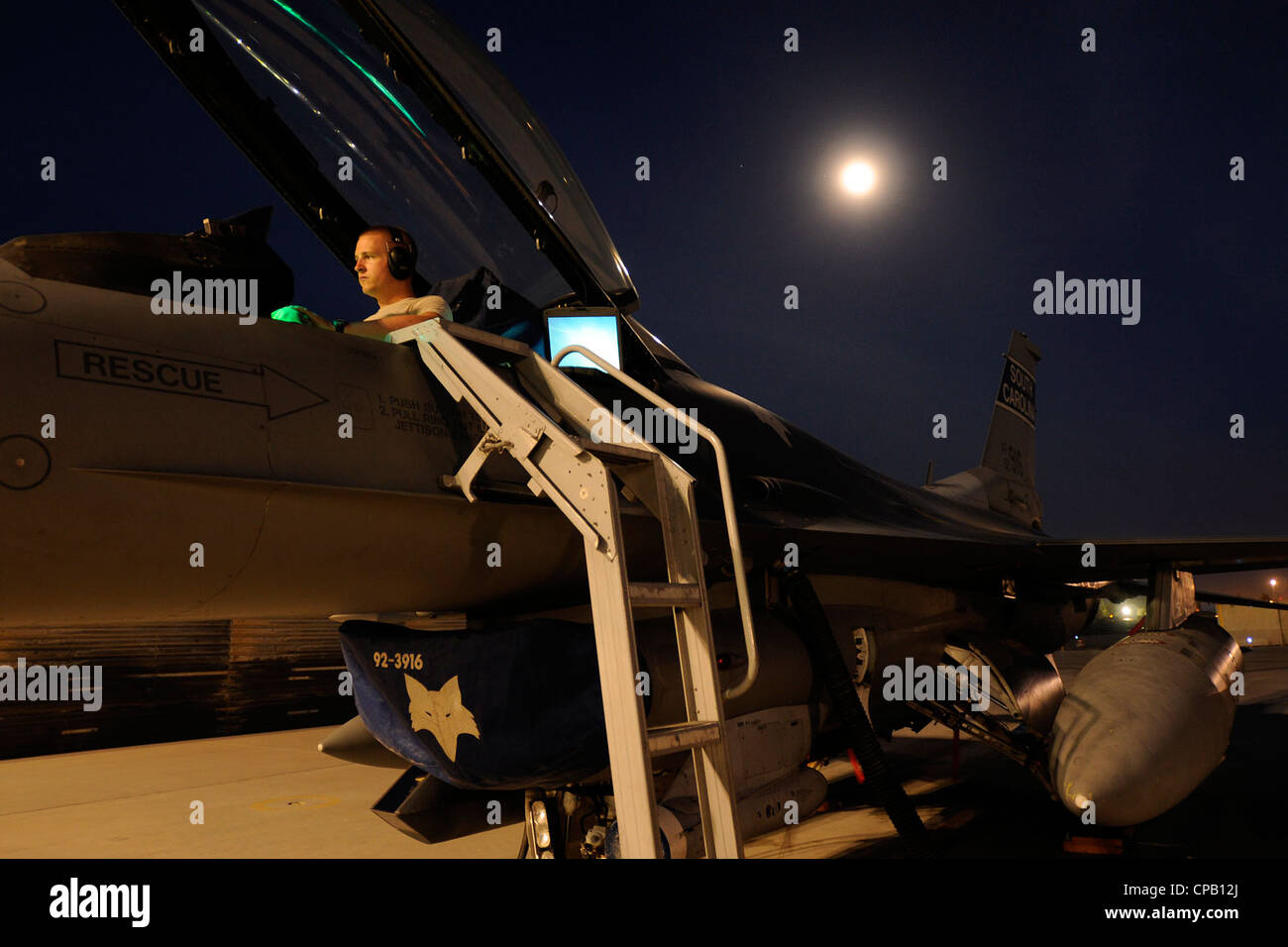 Staff Sgt. Corey Revels, an avionics technician assigned to the 451st Expeditionary Aircraft Maintenance Squadron - Stock Image
