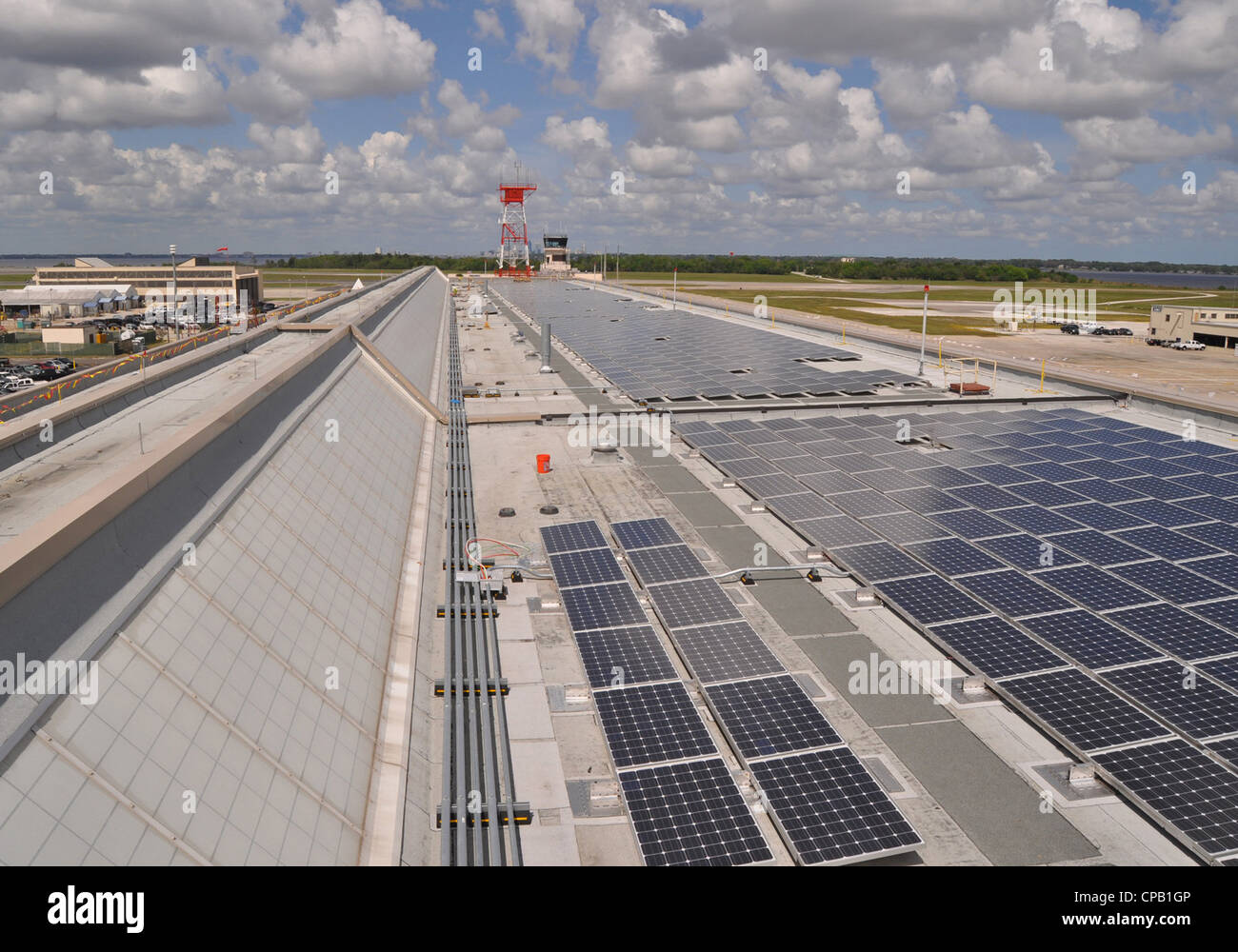 ) Some of the 2,534 solar photovoltaic (PV) panels installed on the roof of Naval Air Station Jacksonville's - Stock Image