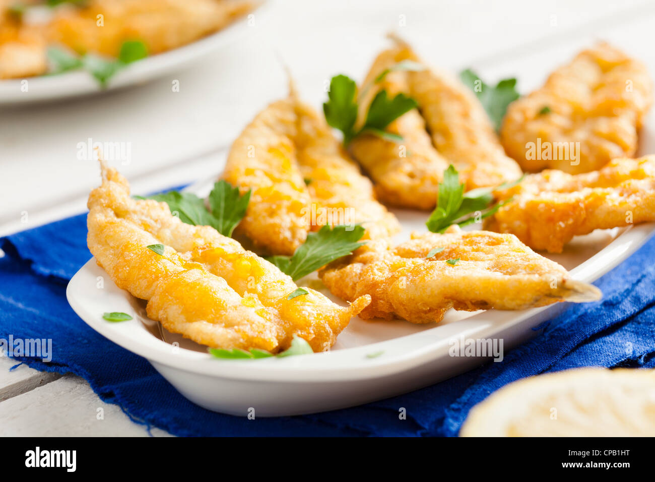 Fried Anchovies with Parsley and Lemon - Stock Image