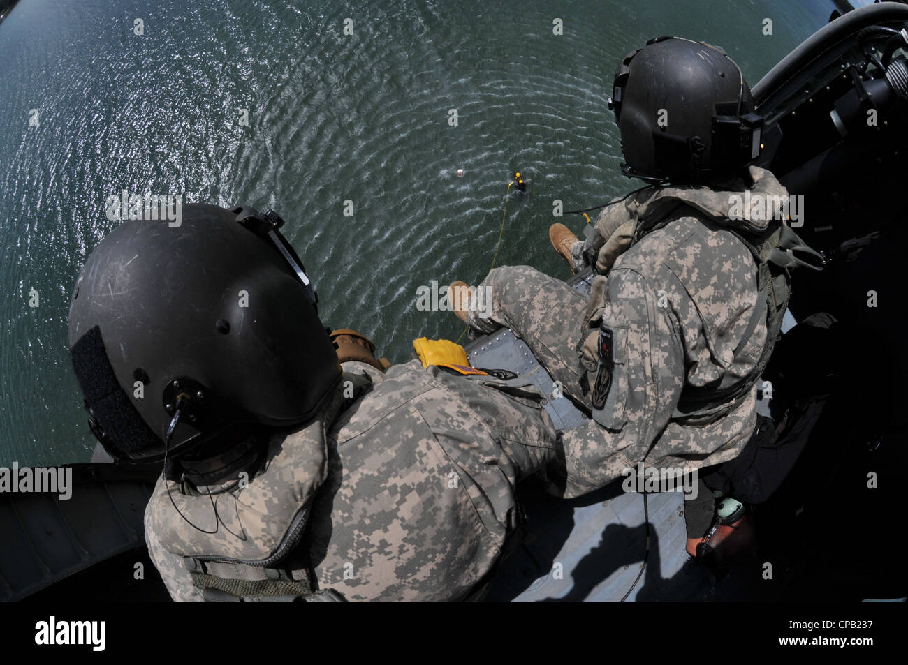 Sgt. 1st Class Robin McDaniel (left) and Sgt. Charles sit ready in a North Carolina Army National Guard UH-60 Black - Stock Image