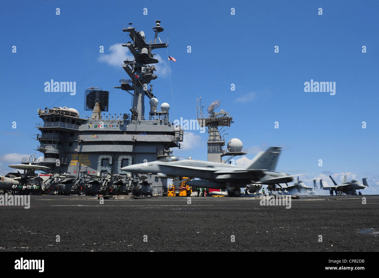 An F/A-18C Hornet from the Rampagers of Strike Fighter Squadron (VFA) 83 lands aboard the Nimitz-class aircraft Stock Photo