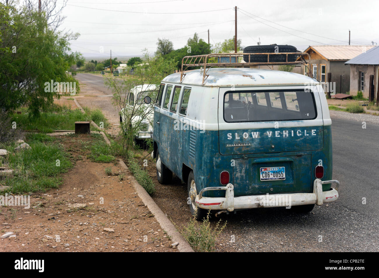 Two VW vintage vehicles in a street of Marathon, a west Texas rural community. Note: license plate altered for privacy - Stock Image