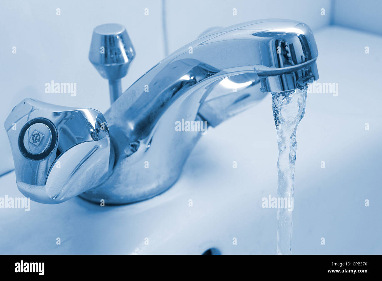 Running water from a faucet - Stock Image