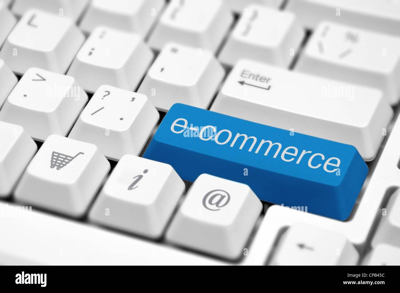 e-commerce key on a white keyboard closeup. E-commerce concept image. - Stock Image
