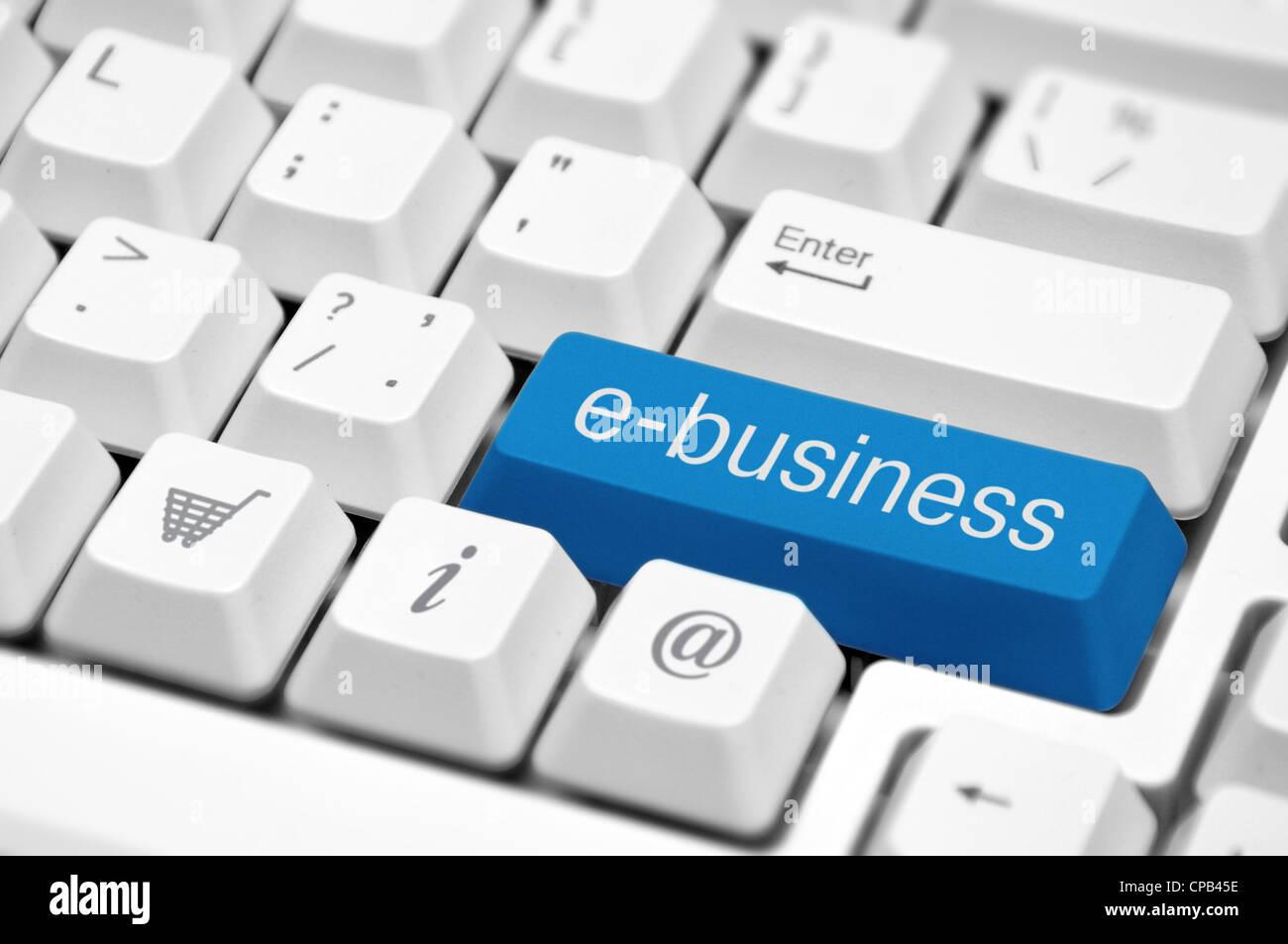 e-business key on a white keyboard closeup. E-business concept image. - Stock Image