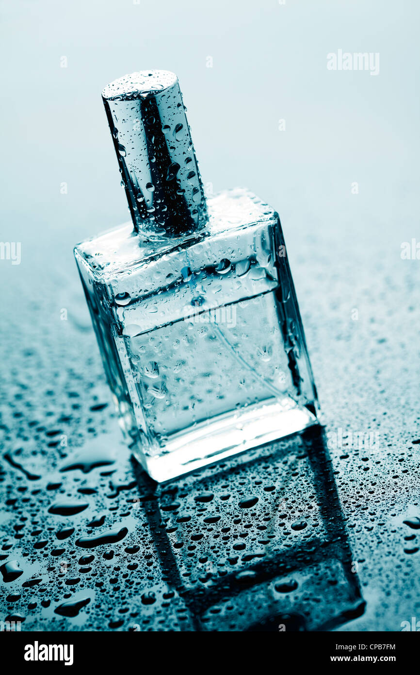 bottle of clear perfume - Stock Image