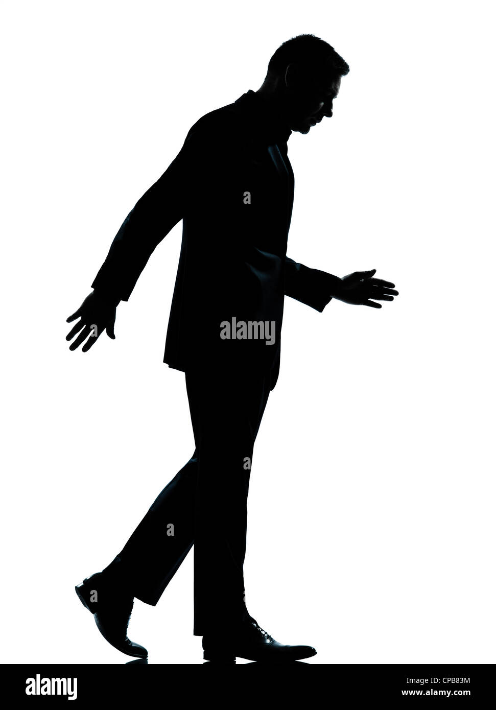 one caucasian business man walking silhouette Full length in studio isolated on white background - Stock Image