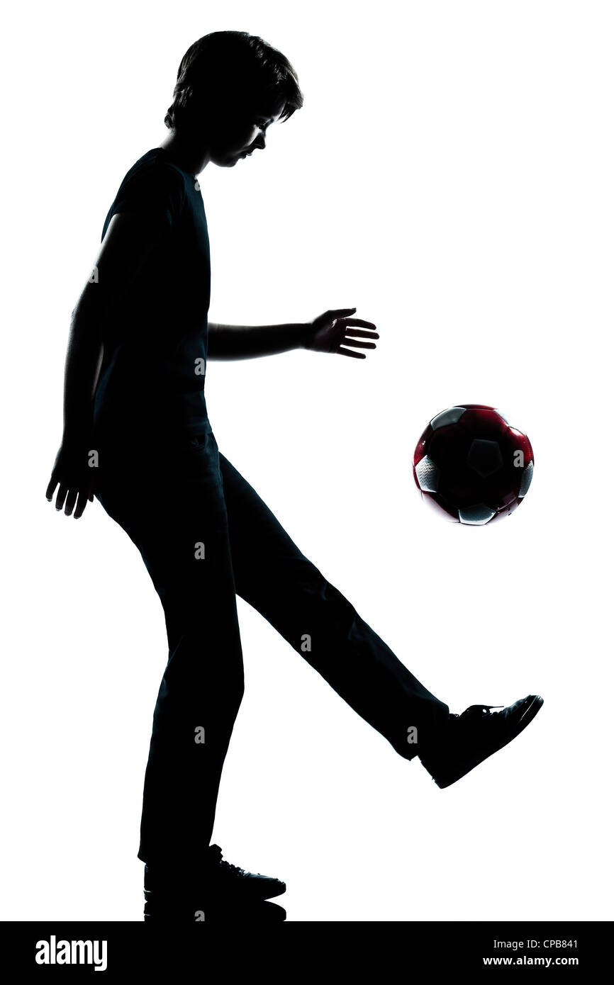 one caucasian young teenager silhouette boy girl  juggling soccer football full length in studio cut out isolated - Stock Image