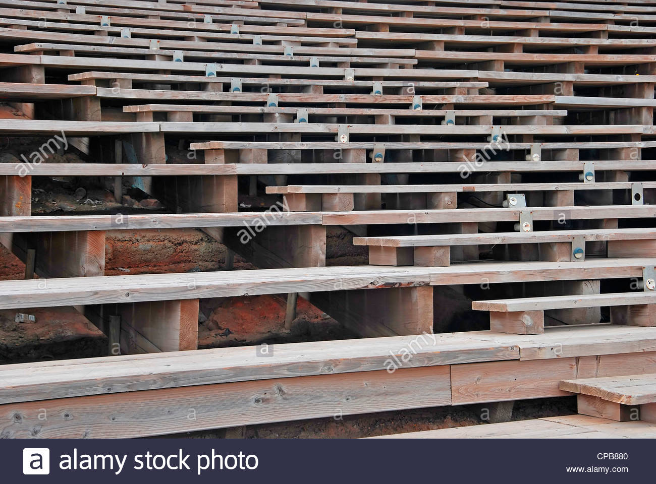 Rows of Wooden seats for an outdoors spectacle - Stock Image